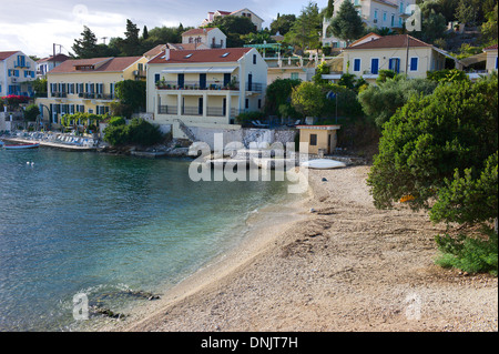 Holiday villas and apartments overlooking the sea at Town Beach, Fiscardo, Kefalonia, Greece - Stock Photo