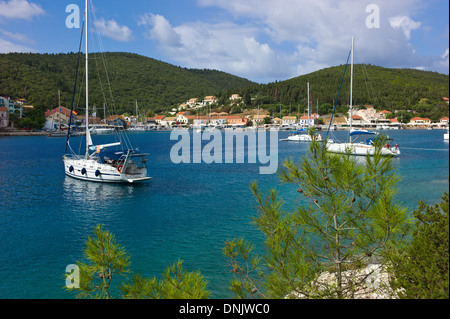 Yacths moored in Fiscardo harbour, Kefalonia, Greece - Stock Photo
