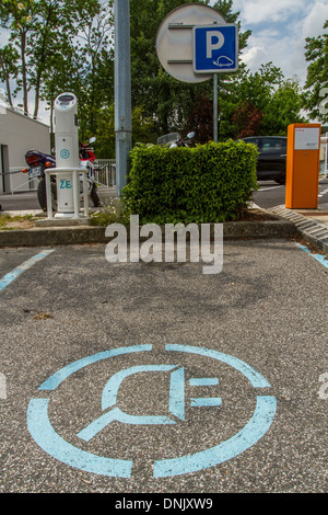PARKING SPOT NEAR A RECHARGING POST, SPOT RESERVED FOR ELECTRIC CARS - Stock Photo