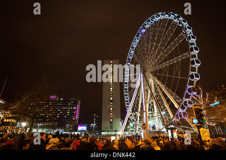 New Year crowds enjoy amusement rides with lights in Manchester, UK 1st January, 2014. Freij World Attractions The - Stock Photo