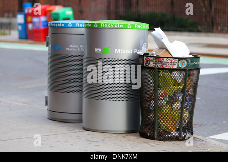NYC garbage can and recycling bins for mixed paper, glass, metal, and plastics. - Stock Photo