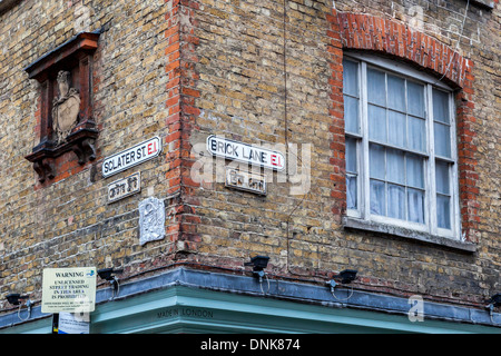 Signs in English and Arabic on corner of Sclater Street and Brick lane, East London, E1, UK - Stock Photo