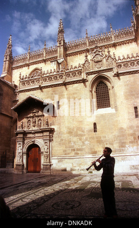 A musician plays the clarinet in front of the Cathedral in Granada, Andalucia, Spain, April 2005. - Stock Photo