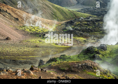 An active geothermal area with multiple steam vents, Landmannalaugar, Iceland - Stock Photo