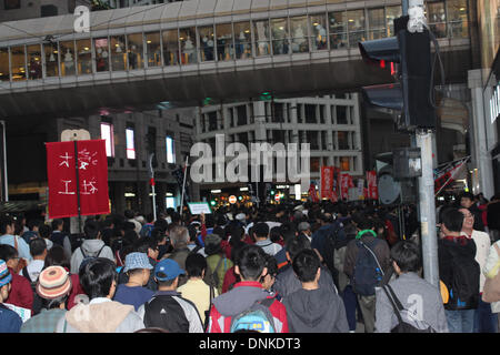 Hong Kong, China. 1st January 2014. Pro-democracy marchers parade through Hong Kong's business district on New Year's - Stock Photo