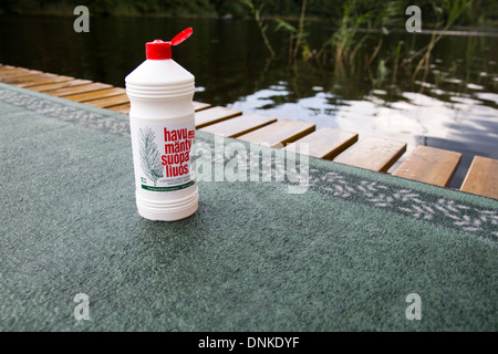 Bottle of liquid tall oil soap , used as carpet washing detergent - Stock Photo