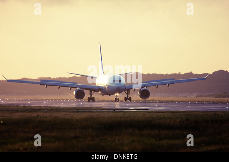 Commercial airliner at London Gatwick Airport runway, England, United Kingdom - Stock Photo