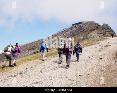 Group of Ramblers walking on Rhyd Ddu path up to Mt Snowdon summit and cafe in Snowdonia National Park North Wales - Stock Photo