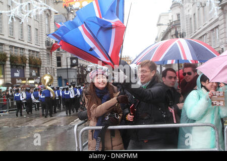 London,UK,1st January 2014,Strong Winds blew umbrellas inside out at the London's New Year's Day Parade 2014 Credit: - Stock Photo