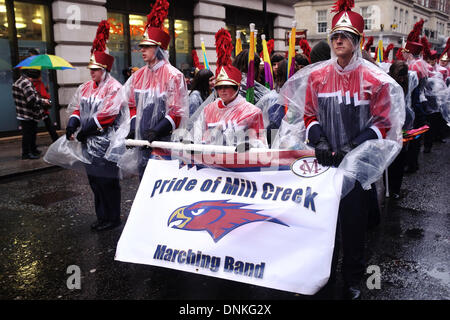 London, UK. 01st Jan, 2014. Participants and spectators in the New Year's Day parade faced wind, rain and cold on - Stock Photo