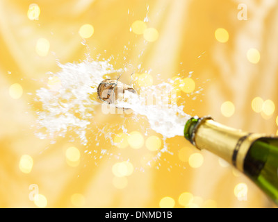Uncorking a bottle of champagne - Stock Photo