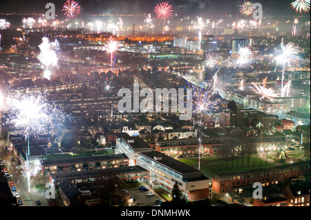 Fireworks on new years eve as seen from a 101 meters high building in the center of Enschede in the Netherlands - Stock Photo