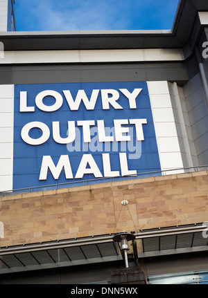 Sign outside an entrance to the Lowry Outlet Mall in Salford Quays near Manchester in England, UK - Stock Photo