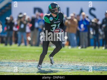 Dallas, Texas, USA. January 1st, 2014: .North Texas Mean Green wide receiver John Chelf (31) picks up a blocked - Stock Photo