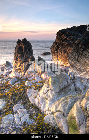 A small sea stack in lovely evening sunset light on the North Somerset coast at Sand Point and Middle Hope, United - Stock Photo