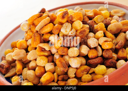 a bowl with mixed nuts, such as roasted and salted peanuts, corn or chickpeas - Stock Photo