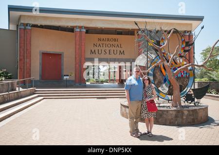White Caucasian couple at entrance to Nairobi National Museum Kenya - Stock Photo