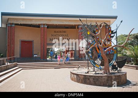 Entrance to Nairobi National Museum Kenya with family of white caucasians entering - Stock Photo