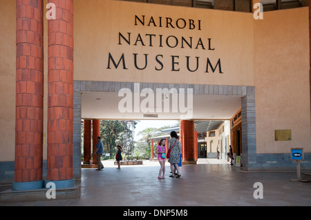 White Caucasian family of adults and children entering the main entrance of the Nairobi National Museum - Stock Photo