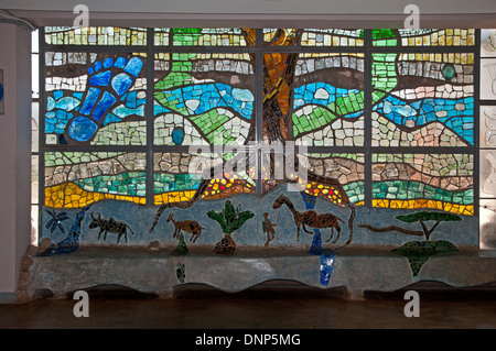 Stained glass window inside entrance of Nairobi National Museum Kenya with trees and wild animals depicted - Stock Photo