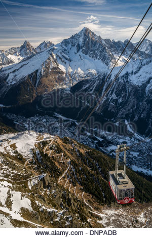 The Brévent cable car and the valley of Chamonix in the Mont Blanc massif (France) - Stock Photo