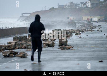 Barmouth, Gwynedd, Wales, UK. 3rd January 2014. Huge waves demolished sea-wall defences and scattering large stones - Stock Photo