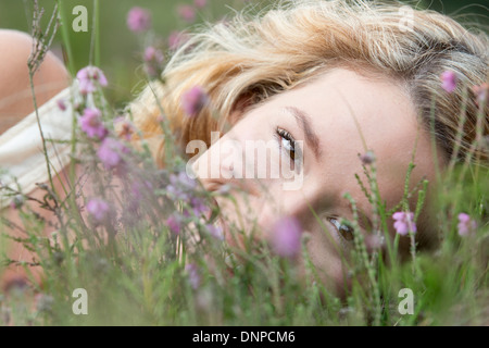 Woman relaxing on meadow - Stock Photo