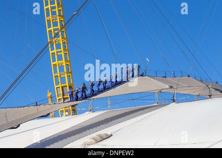 Up at the O2, people climbing the dome roof, Millennium Dome, Greenwich, London - Stock Photo