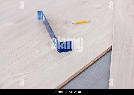 Tool for laying laminate flooring and laminate panels - Stock Photo