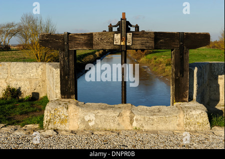 Narrow channel containing water from the sea in Talmont sur Gironde in Charente-Maritime, France - Stock Photo