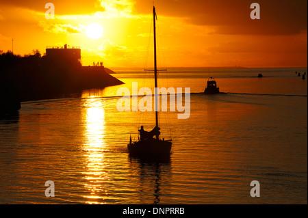 Sunset over the harbor entrance of La Rochelle, Charente-Maritime, southwestern France - Stock Photo