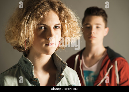 Close-up of Teenage Girl and Boy, Studio Shot - Stock Photo