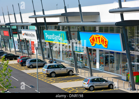 Free disabled parking bays outside retail park shopping units including Smyths, Poundland, Nike, and M&S Outlet - Stock Photo