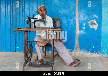 Tailor in front of his shop in the town of Kalabo in western Zambia. - Stock Photo