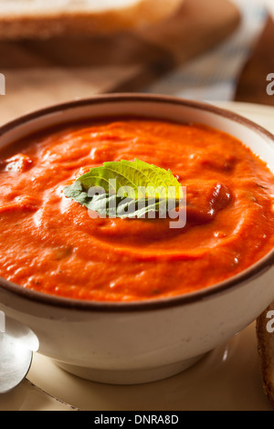 Creamy Tomato Basil Bisque Soup with Bread - Stock Photo