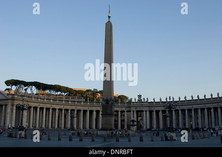 Four-thousand-year-old Egyptian obelisk in St. Peter's Square, Vatican City, along with the Tuscan colonnades