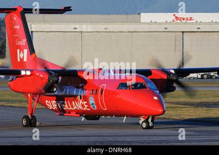 Transport Canada Dash 8 marine aerial surveillance airplane C-GSUR taxies on airport tarmac after patrol of Canada's - Stock Photo