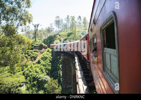 Train from Badulla to Kandy passing on a bridge near the town of Ella in the Hill country, Sri Lanka. - Stock Photo