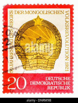 GDR - CIRCA 1971: Postage stamp printed in the GDR shows the date of the 50th anniversary of the victory of the - Stock Photo