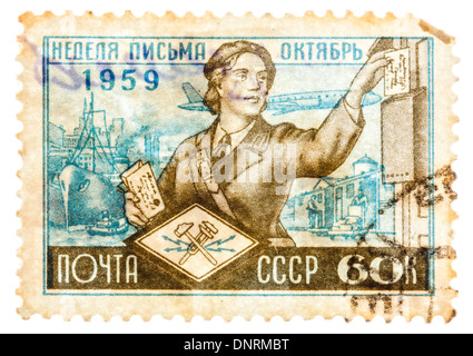 USSR - CIRCA 1959: Postcard printed in the USSR shows Soviet postman at work, circa 1959 - Stock Photo