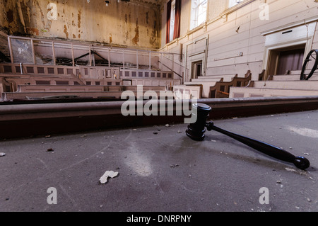 Gavel on the bench in an abandoned courthouse - Stock Photo