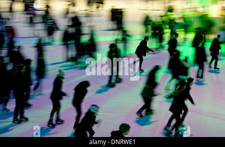 Hamburg, Germany. 04th Jan, 2014. A photo taken with multiple exposure shows skaters on the ice rink in the Planeten - Stock Photo