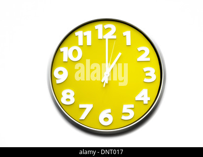 yellow clock face 1 o'clock the clock strikes one 1300 hours - Stock Photo
