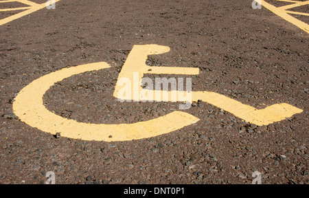 The symbol painted in a car park space reserved for people with a disabled person's 'blue badge' parking permit - Stock Photo