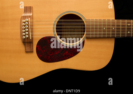 Acoustic guitar isolated on black background. - Stock Photo