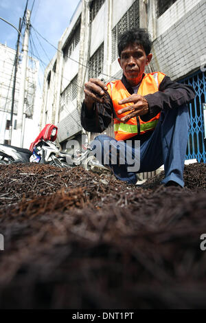 Jakarta, Jakarta, Indonesia. 6th Jan, 2014. Each day before dawn the repairmen sabotage streets by dumping hundreds - Stock Photo