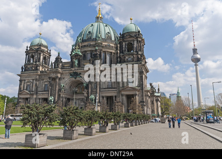 The Berliner Dom which is located on Museum Island with the television tower in the distance in Berlin, Germany - Stock Photo