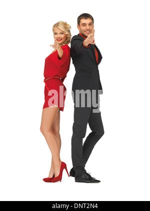 man and woman making a gun gesture - Stock Photo