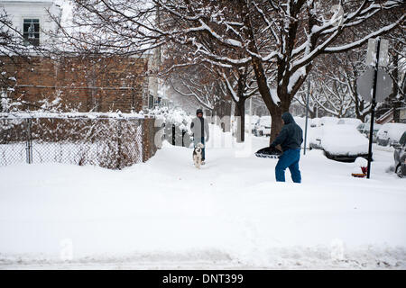 Chicago, Il, USA. 5th Jan, 2013. Following a mild Saturday, heavy snowfall and rapidly dropping temperatures return - Stock Photo