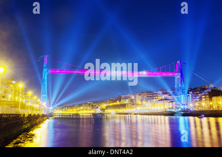 Hanging bridge between Portugalete and Getxo at night with celebration lighting due to new year. Basque Country. - Stock Photo